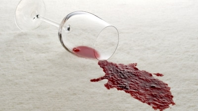 Glass of red wine spilled on white carpet | How-to-remove-wine-stains